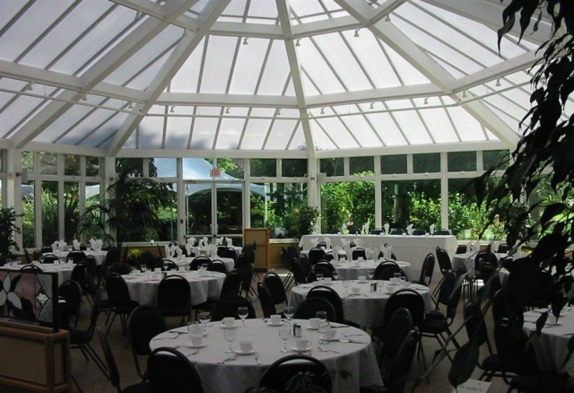 Interior view of a large white commercial conservatory