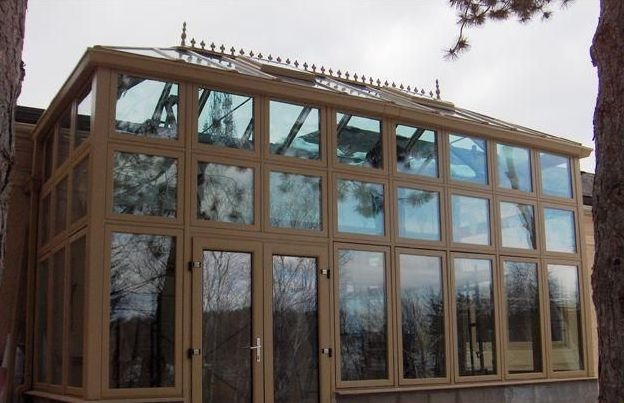 Exterior view of a Brown Edwardian-style Conservatory