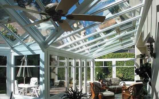A different interior view of a large white Victorian-style conservatory