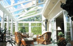 An interior view of a furnished white sunroom