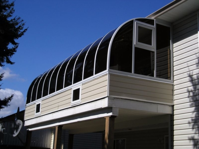 Exterior view of a sunroom attached to the second storey of a house