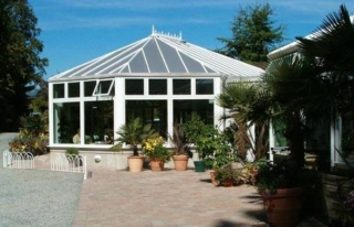 Exterior view of a large white Victorian-style conservatory