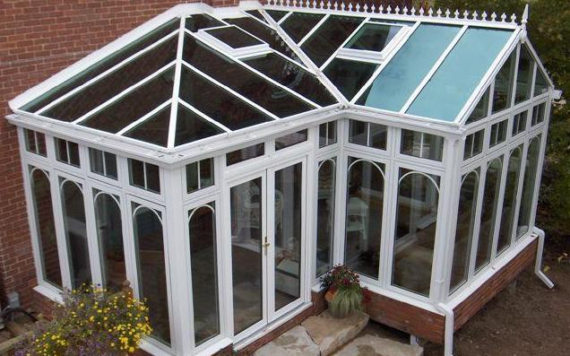 White combined style conservatory on brick building high-angled view