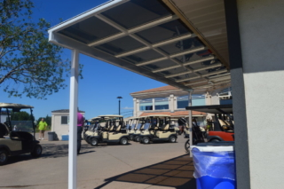 A small patio cover used to shade a lunch counter at a golf course