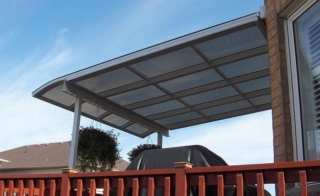A small grey curved end patio cover