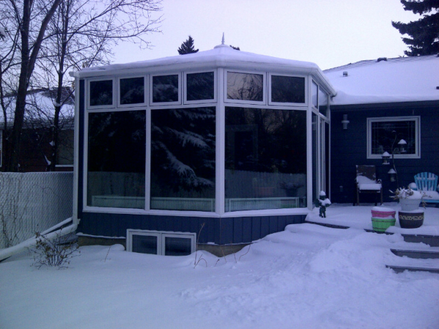Exterior View of a white and blue conservatory during winter