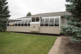 Exterior view of large sunroom with fireplace