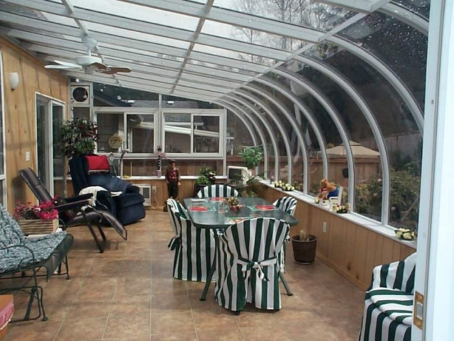 Decorated interior view of a large white sunroom