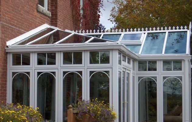 White combined style conservatory on brick building