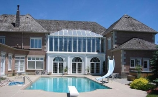 Two-Storey White Conservatory Overlooking Pool