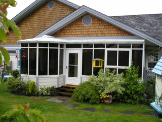 A combined sunroom and conservatory on the back of a house