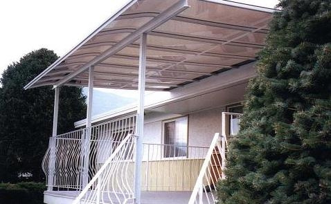 White curved end patio cover over a deck with white railings