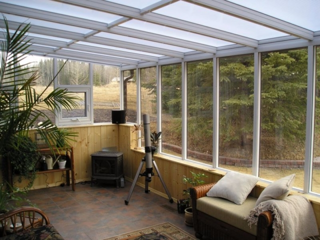 Alternate interior view of a white straight eave sunroom