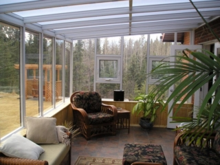 Decorated interior view of a white straight eave sunroom