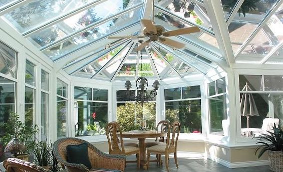 Interior view of a large white Victorian-style conservatory