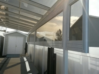 Grey patio cover on exterior of house in Montana
