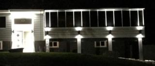 White Sunview Solariums solarium on front of house in Montana
